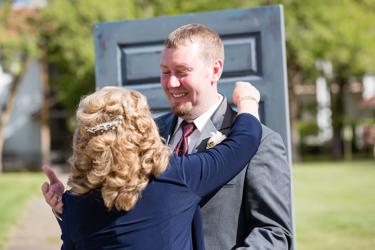 heritage-hall-missoula-montana-groom-hugs-mother-in-law-ceremony.jpg