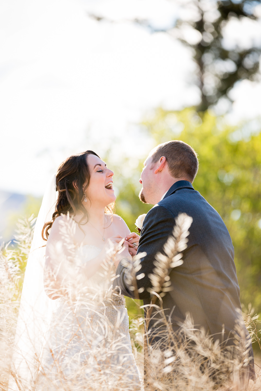 heritage-hall-missoula-montana-bride-groom-laughing-in-field.jpg