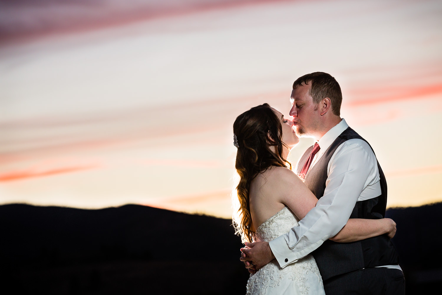heritage-hall-missoula-montana-bride-groom-sunset-kiss.jpg