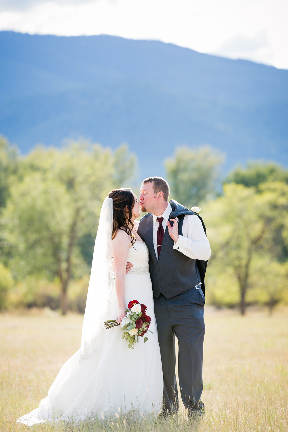 heritage-hall-missoula-montana-groom-kisses-brides-nose.jpg