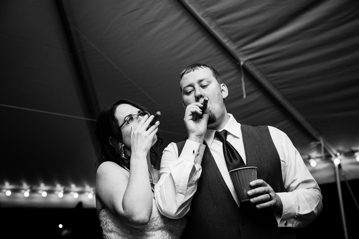 heritage-hall-missoula-montana-bride-groom-puff-cigars.jpg