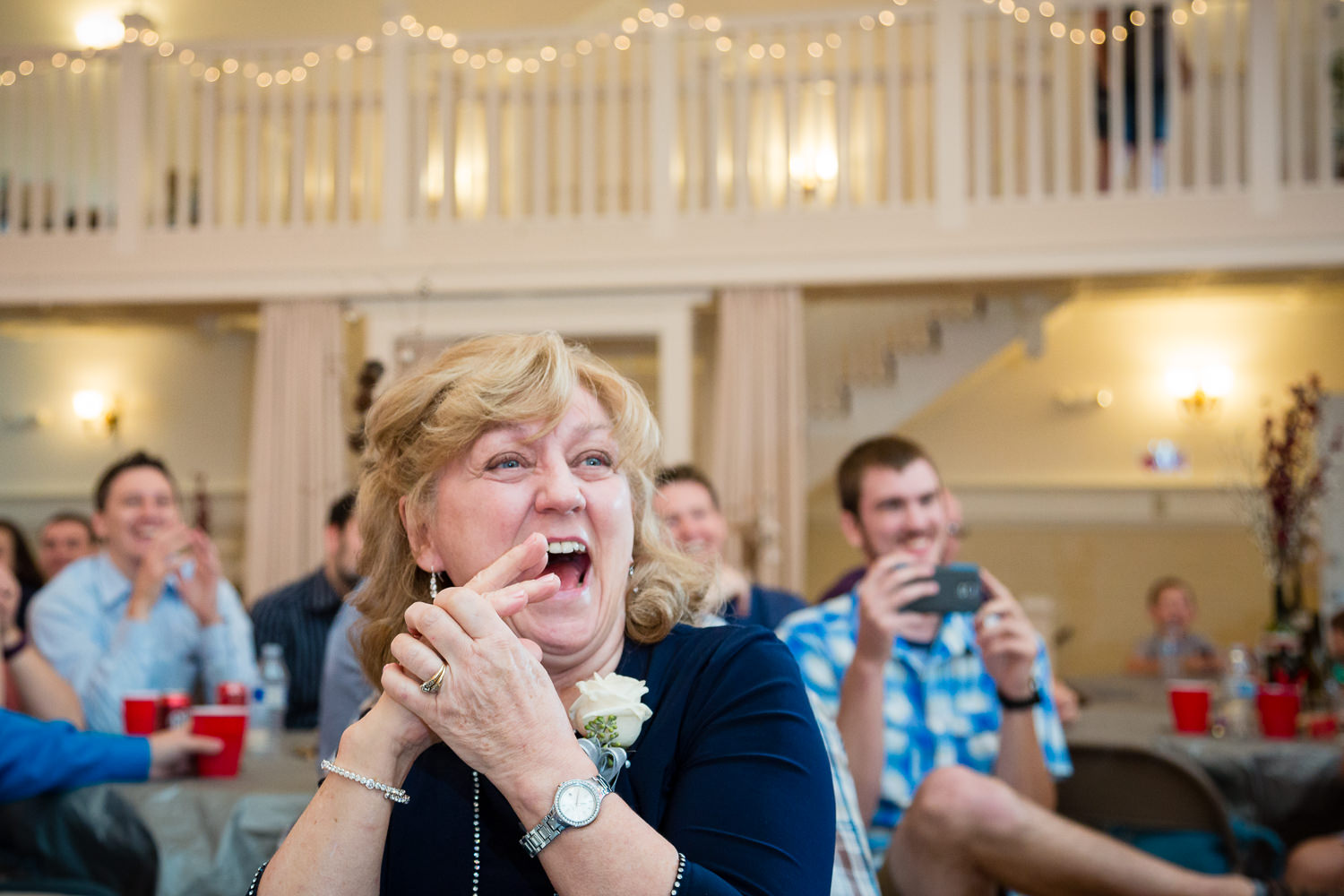 heritage-hall-missoula-montana-brides-mom-laughing-during-toasts.jpg