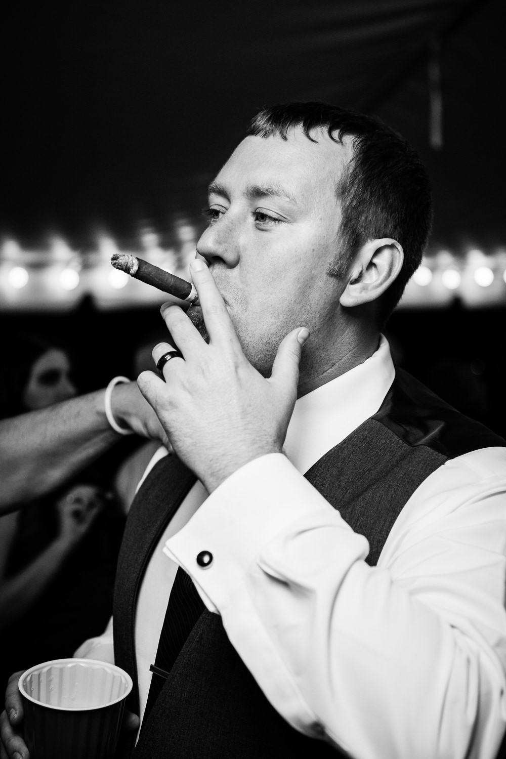 heritage-hall-missoula-montana-groom-smokes-cigar.jpg