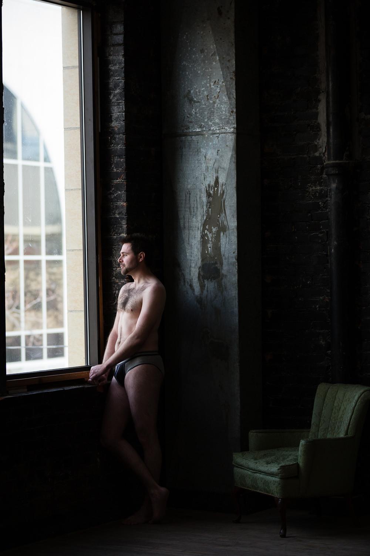 billings-montana-boudoir-man-looking-out-window.jpg