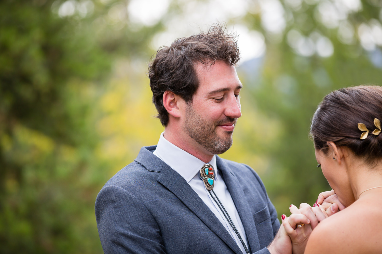 big-sky-montana-gallatin-riverhouse-wedding-bride-kisses-grooms-hands.jpg