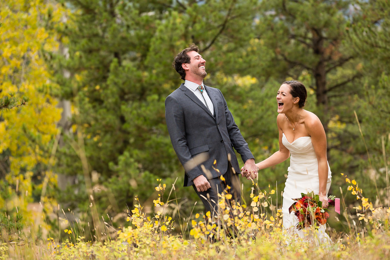 big-sky-montana-gallatin-riverhouse-wedding-first-look-laughter.jpg