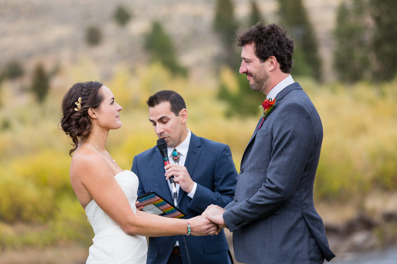 big-sky-montana-gallatin-riverhouse-wedding-bride-groom-exchange-vows.jpg