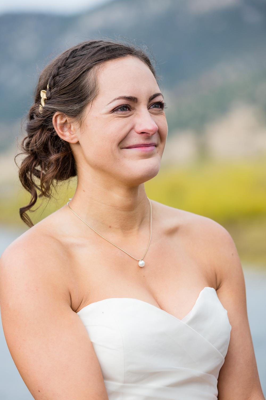 big-sky-montana-gallatin-riverhouse-wedding-bride-smiles-during-ceremony.jpg