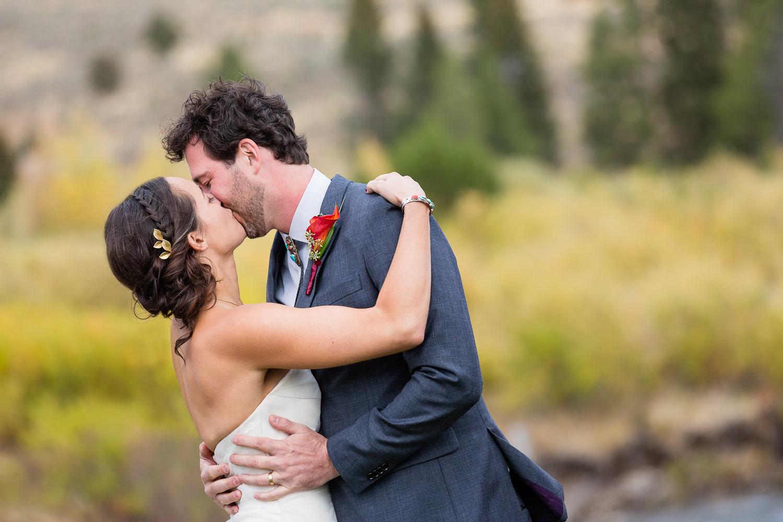 big-sky-montana-gallatin-riverhouse-wedding-ceremony-kiss.jpg