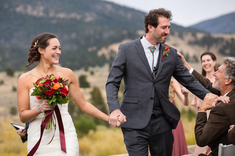 big-sky-montana-gallatin-riverhouse-wedding-dad-congratulates-groom.jpg