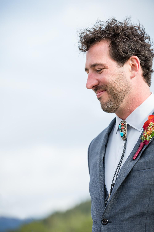 big-sky-montana-gallatin-riverhouse-wedding-groom-during-ceremony.jpg