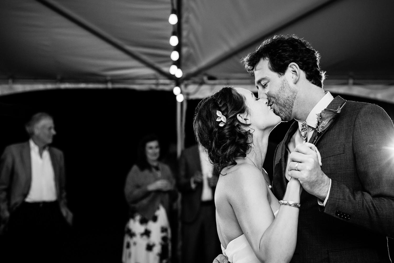 big-sky-montana-gallatin-riverhouse-wedding-bride-groom-kiss-during-first-dance.jpg