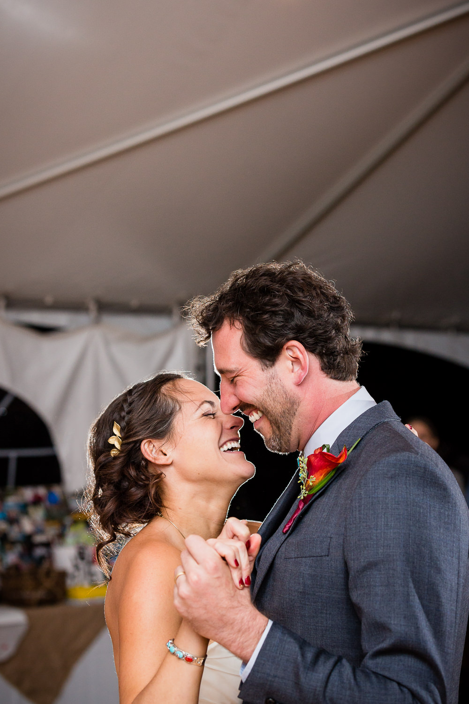 big-sky-montana-gallatin-riverhouse-wedding-bride-groom-laugh-during-first-dance.jpg