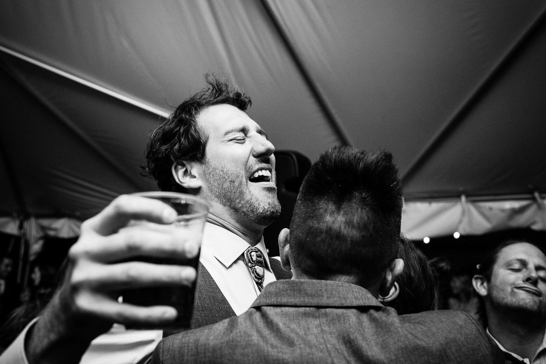 big-sky-montana-gallatin-riverhouse-wedding-groom-drinking-beer-laughing.jpg