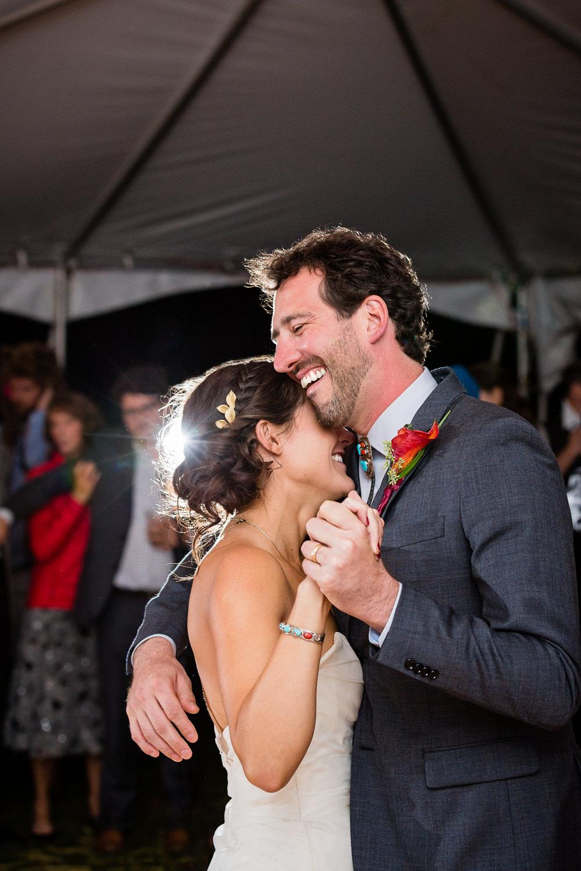 big-sky-montana-gallatin-riverhouse-wedding-groom-hugs-bride-first-dance.jpg