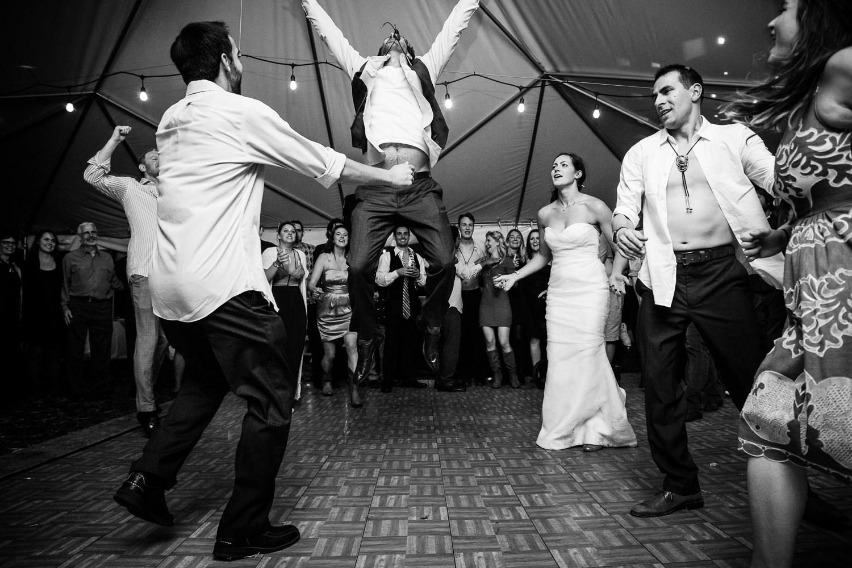 big-sky-montana-gallatin-riverhouse-wedding-groom-leaps-off-dance-floor.jpg