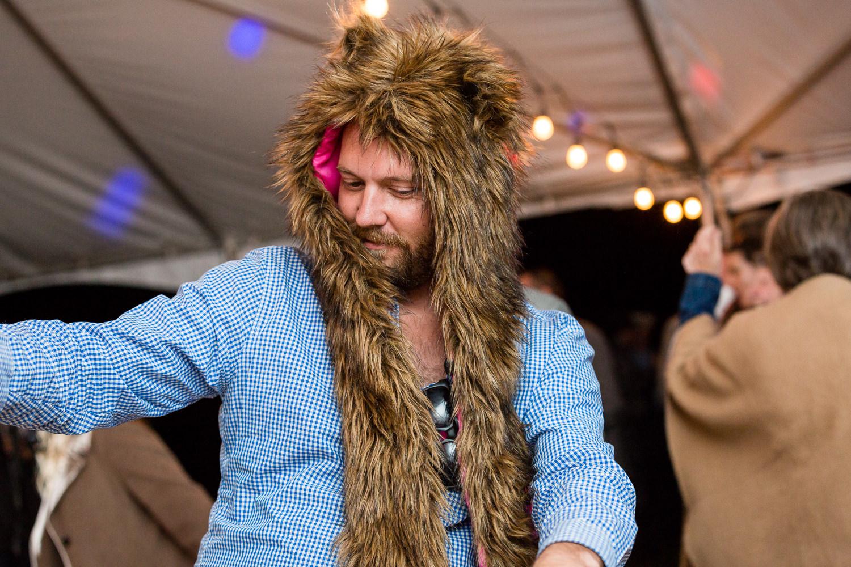 big-sky-montana-gallatin-riverhouse-wedding-guest-dancing-in-animal-hat.jpg