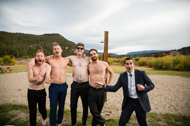 big-sky-montana-gallatin-riverhouse-wedding-men-posing-without-shirts.jpg