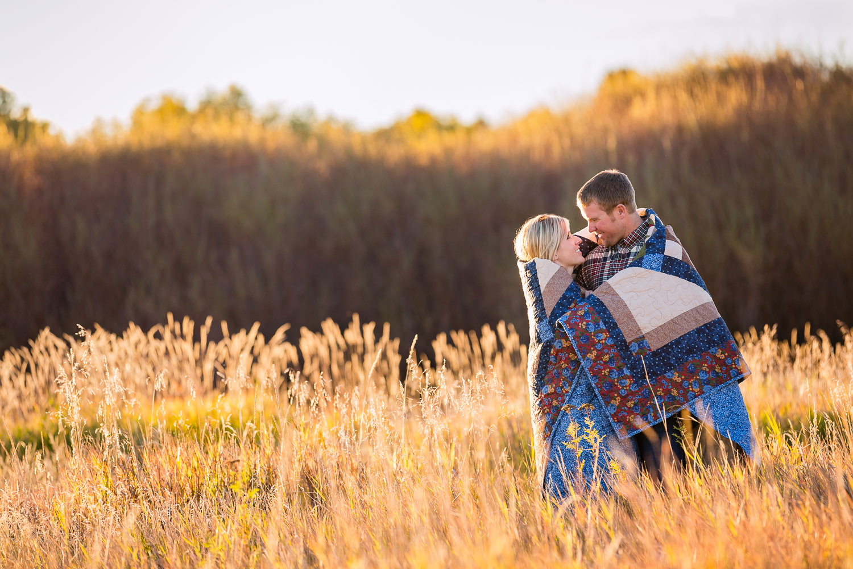 bozeman-montana-engagement-session-fall-season-couple-wrapped-in-blanket.jpg