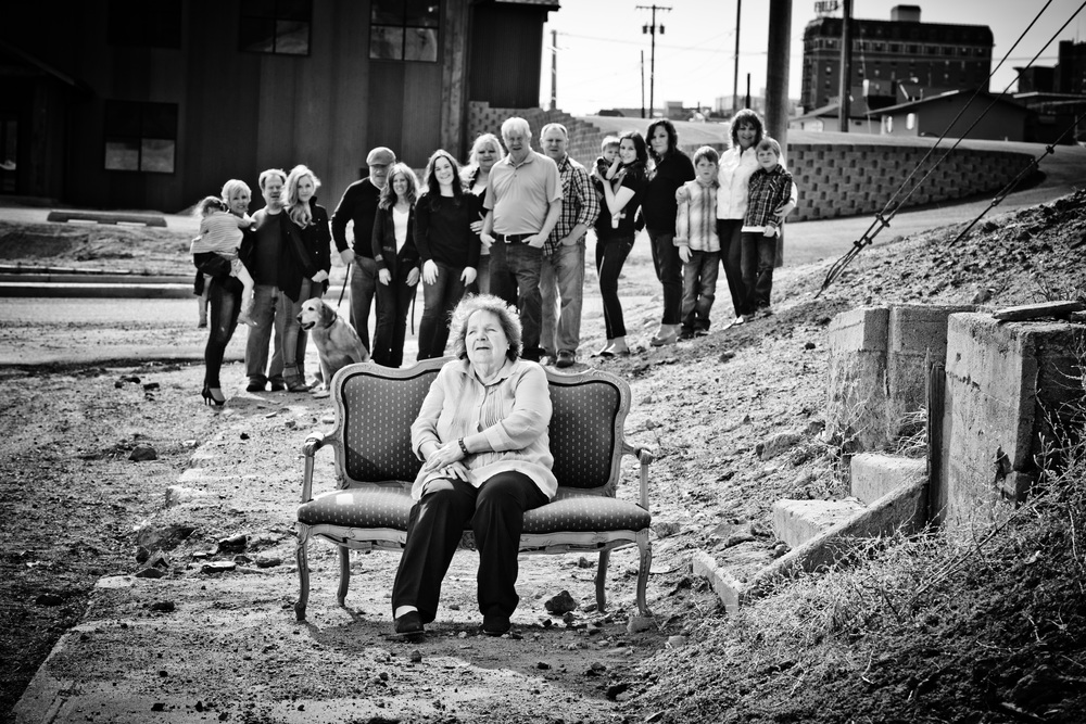 "Florence ""Toots"" Vucurovich is seated next to her old neighbor's front steps at camera right (the home is now demolished) and in front of where her old family home used to exist (where the new brewery is now)."