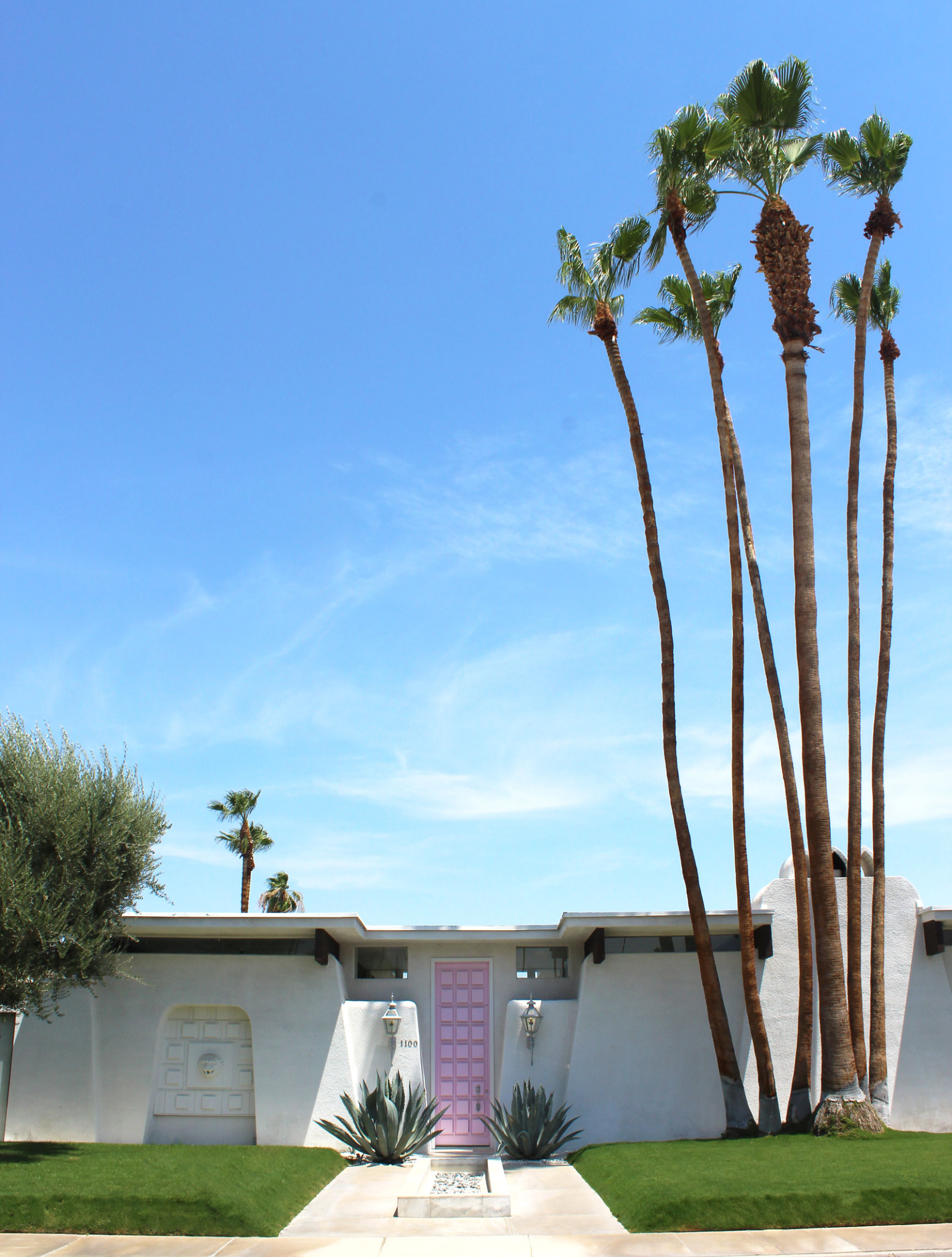 Pink door house in Palm Springs - love the midcentury modern architecture and palm trees  Sundays and Somedays