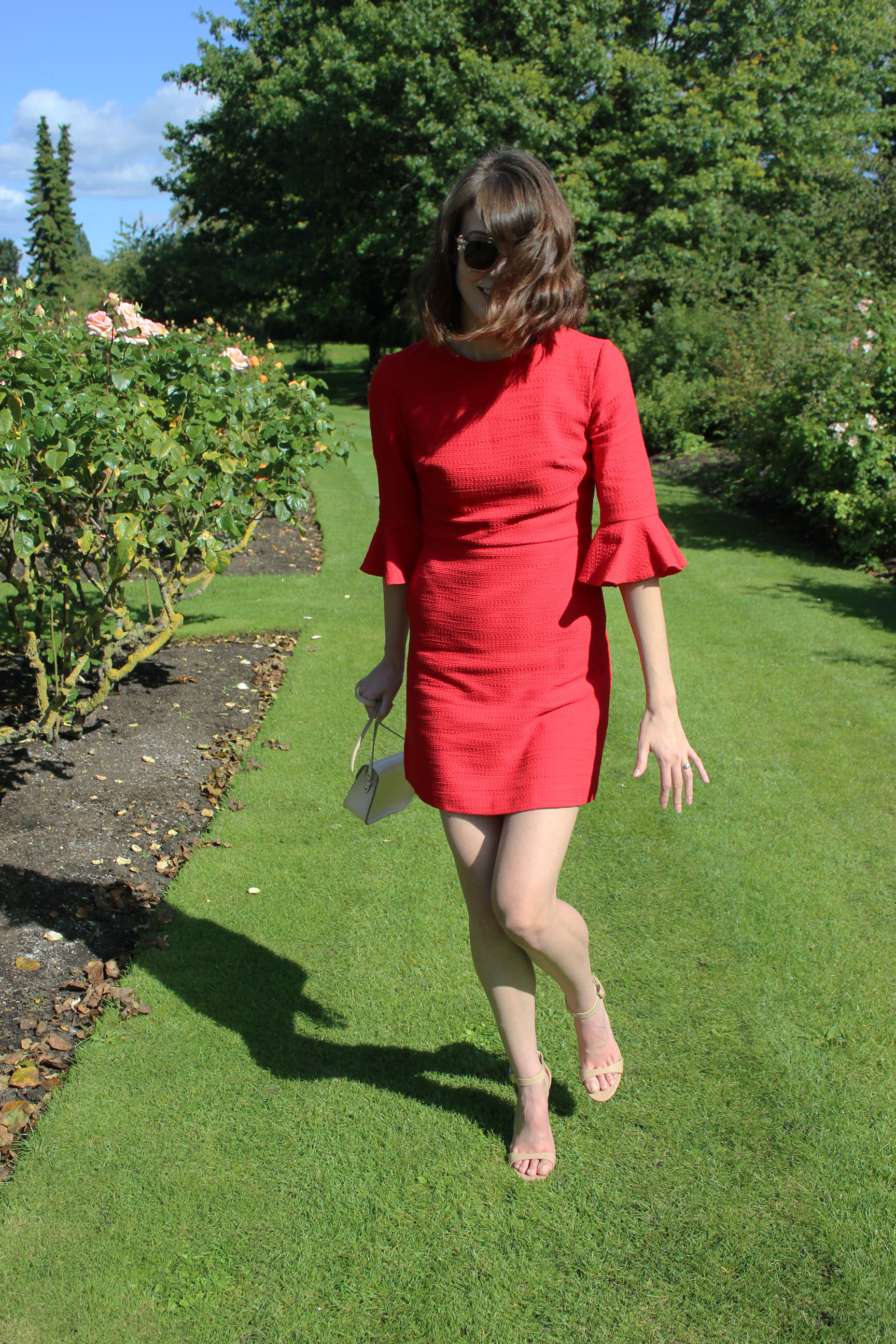 Red Topshop dress with tulip sleeves perfect for transitioning from summer to fall.