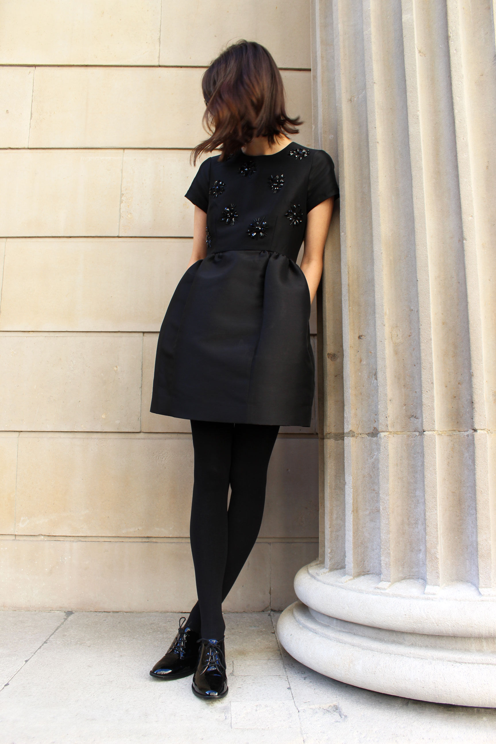 Kate Spade little black dress, paired with opaque tights and patent loafers.