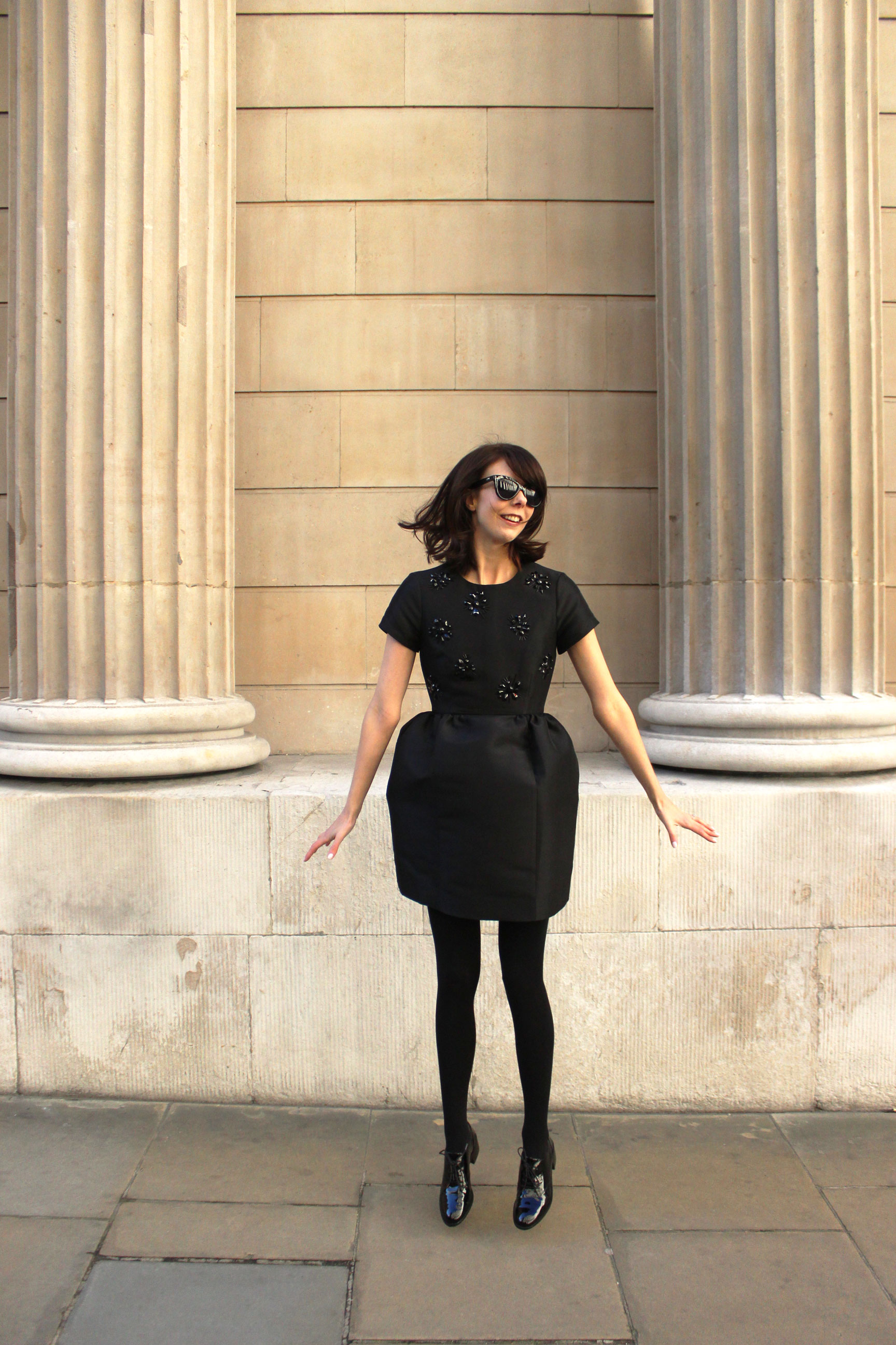 Jumping for joy in my favorite little black dress from Kate Spade.