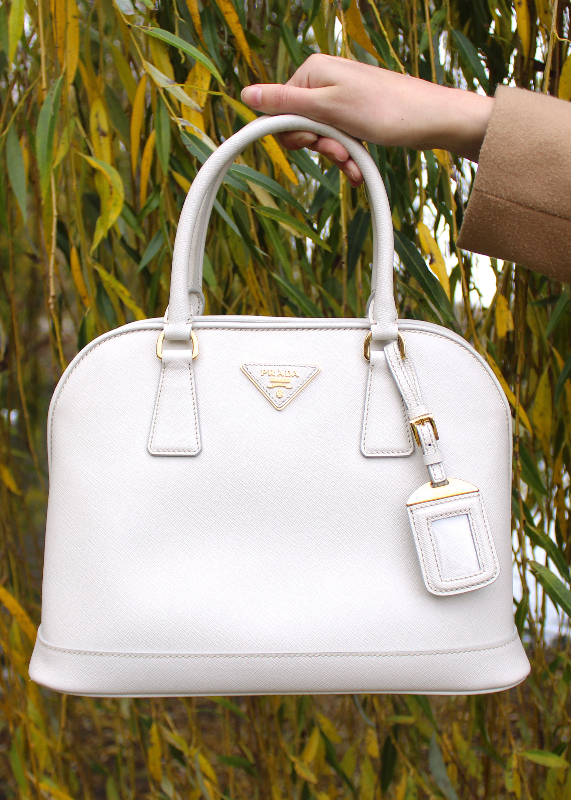 White Prada saffiano leather bag.
