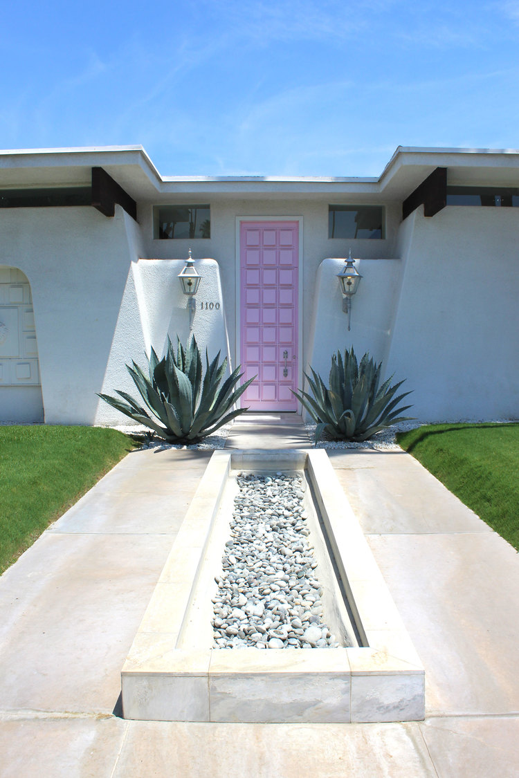 Visiting the iconic pink door house in Palm Springs, California.