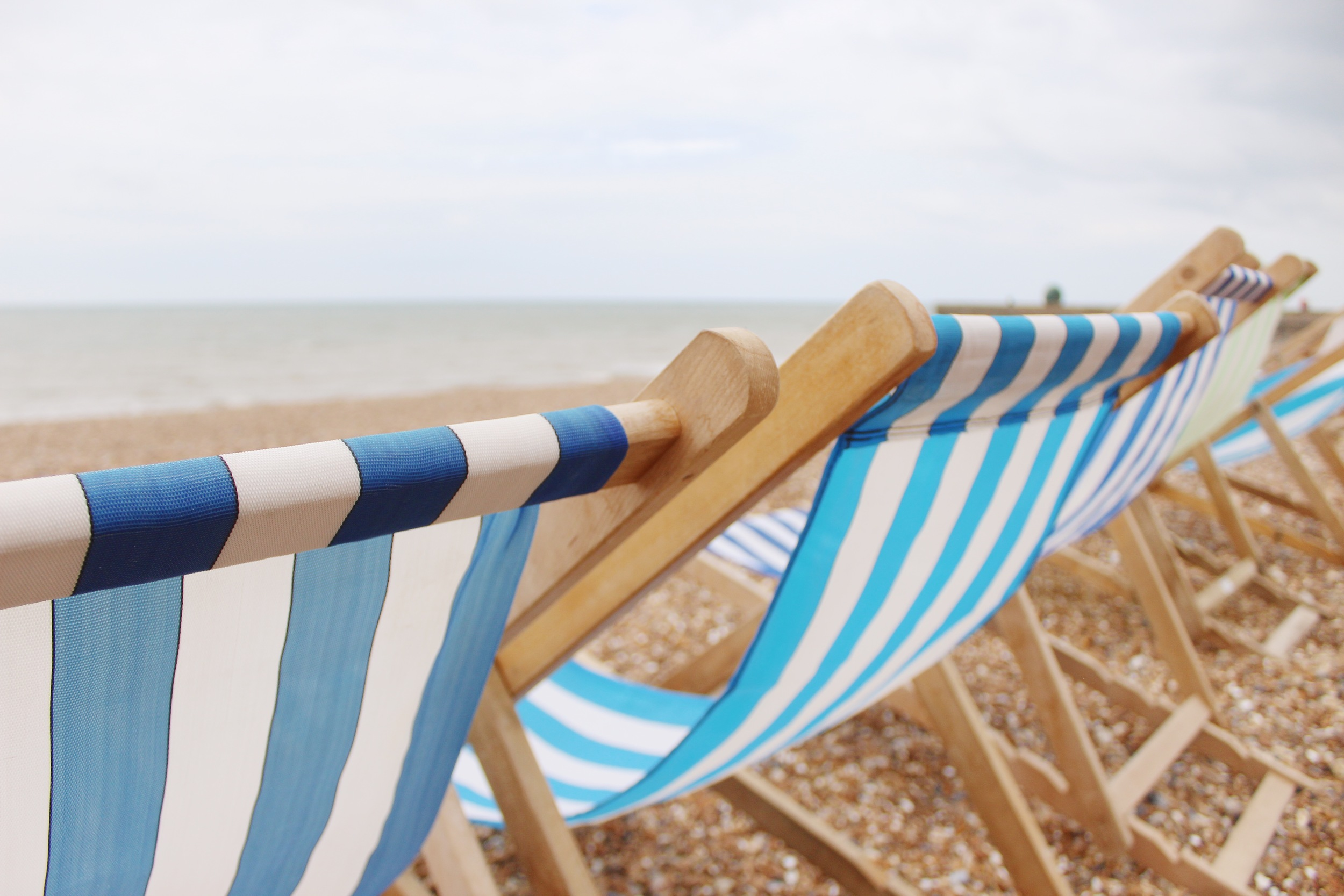 A close-up of the charming striped beach chairs on Brighton Beach.