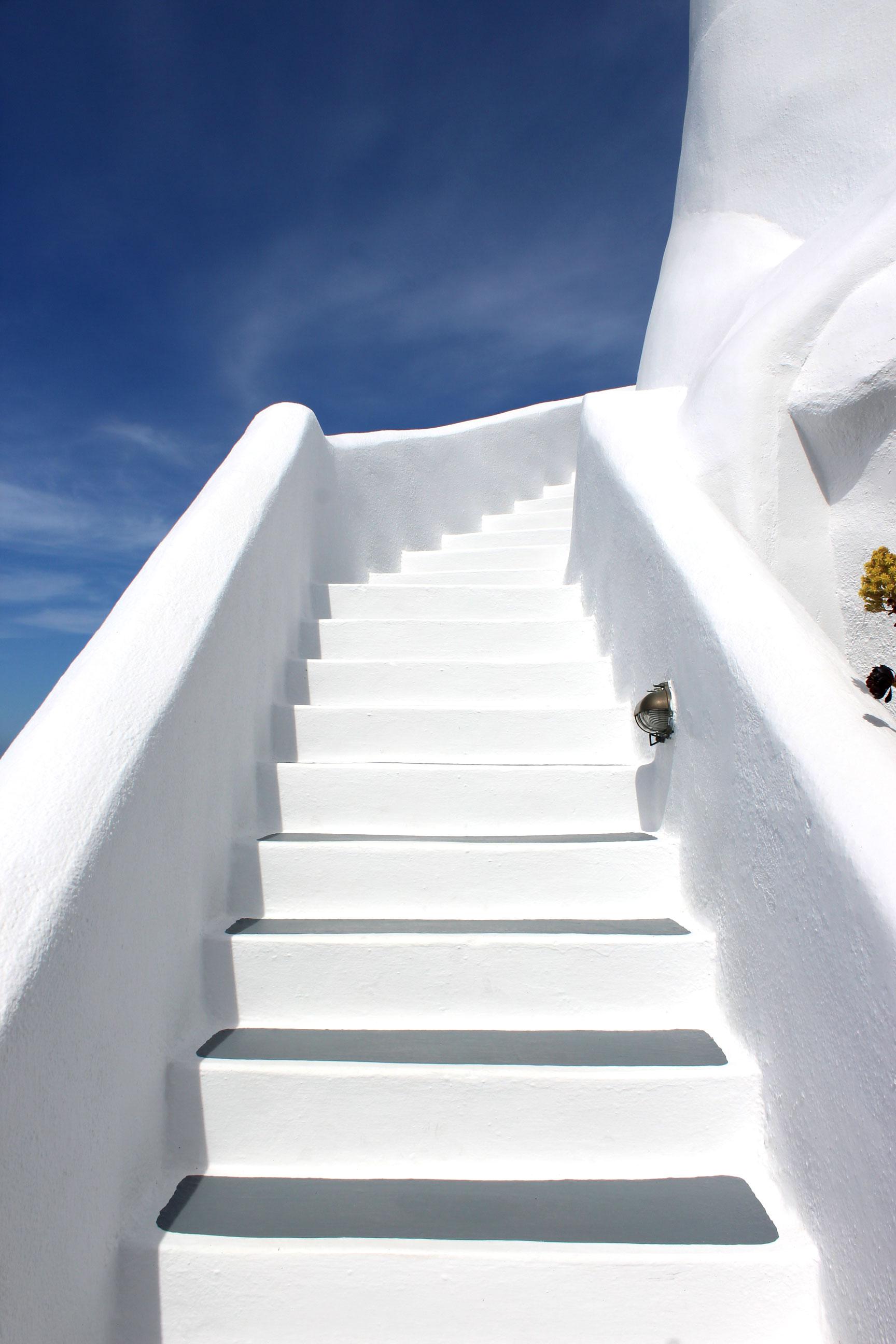 Blue skies and white walls at Ikies Hotel in Santorini.