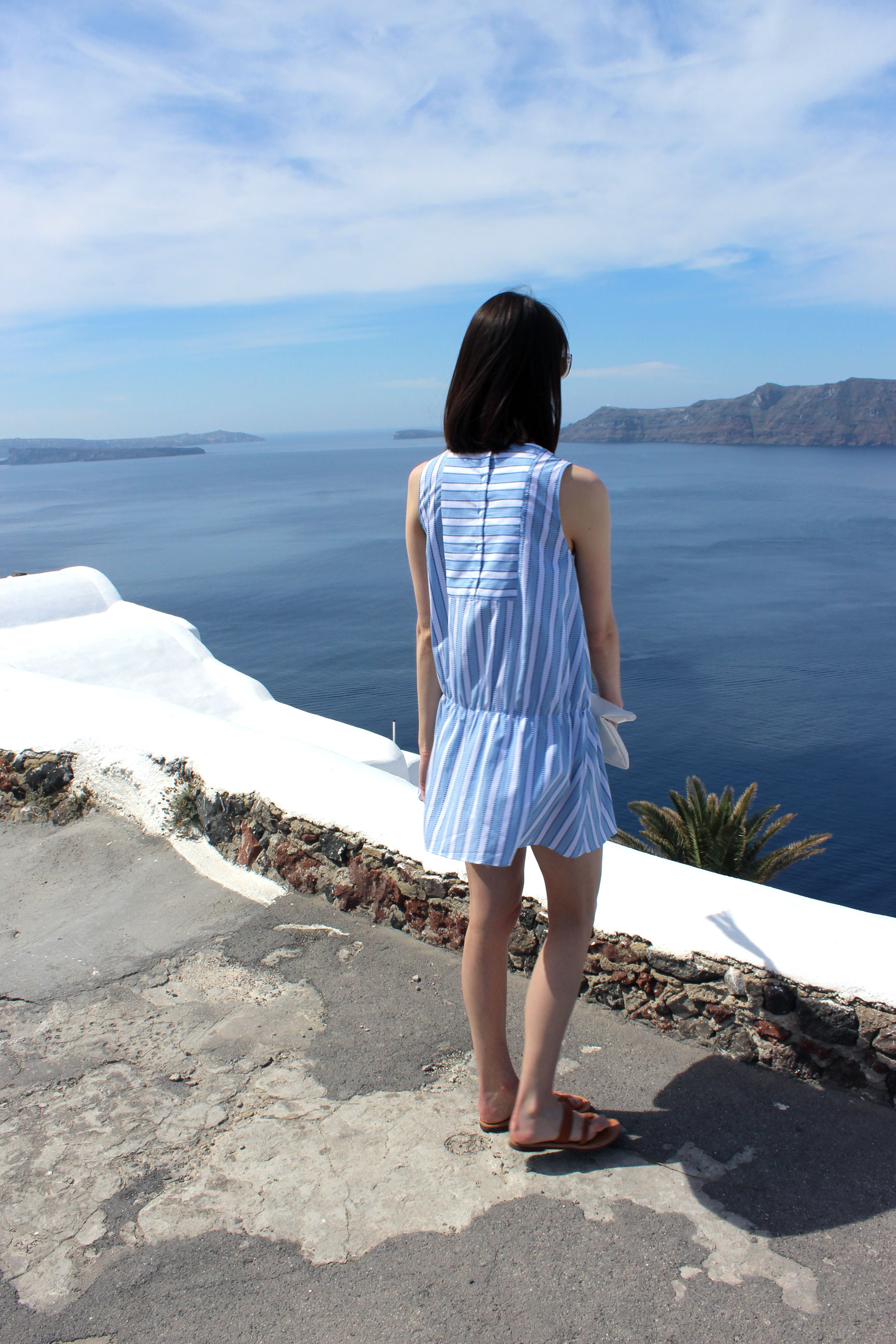 Admiring the endless blue skies and waters on the island of Santorini, Greece.