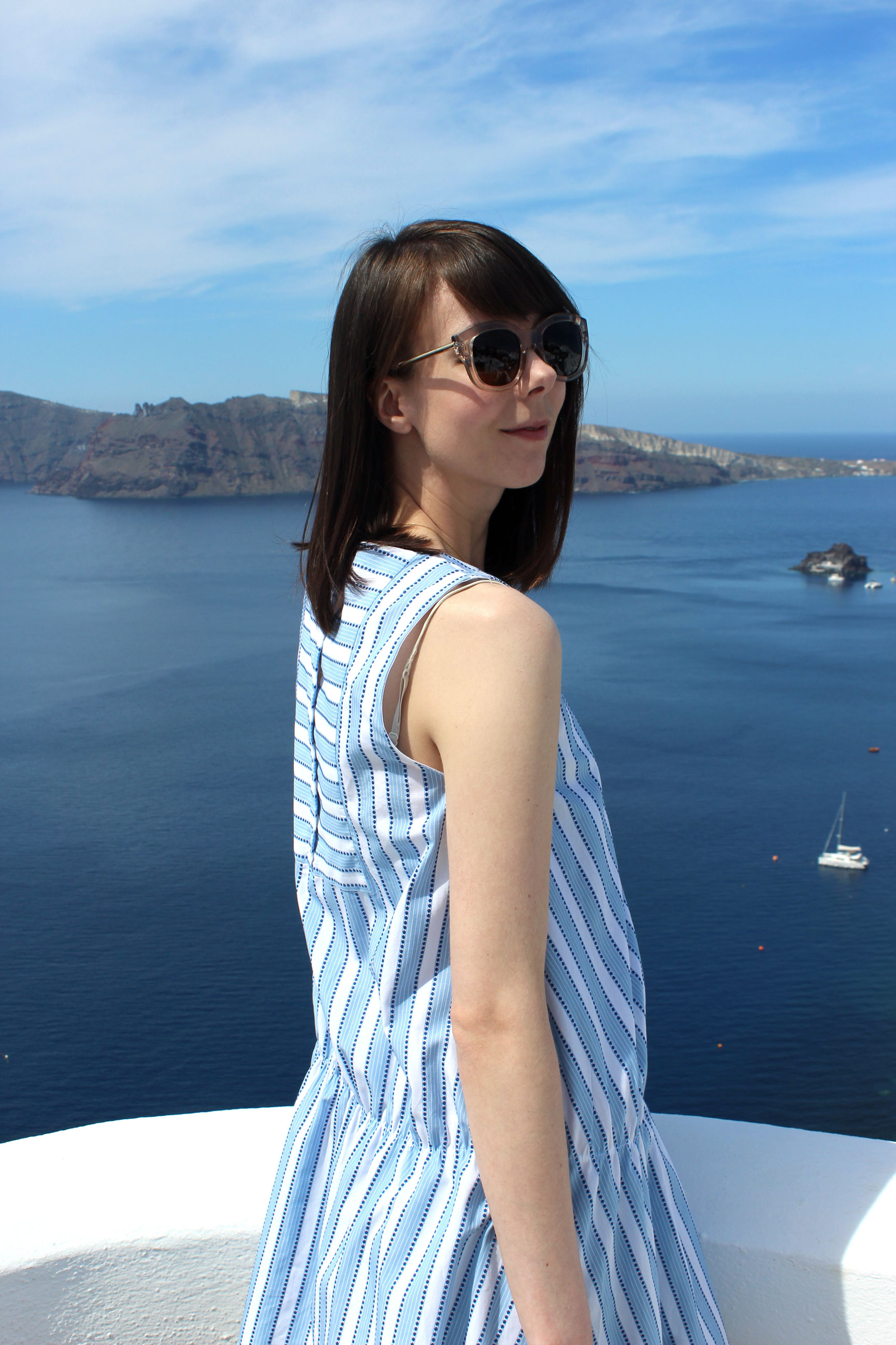 Wearing a Zara dress to match the blue skies and waters of Santorini.