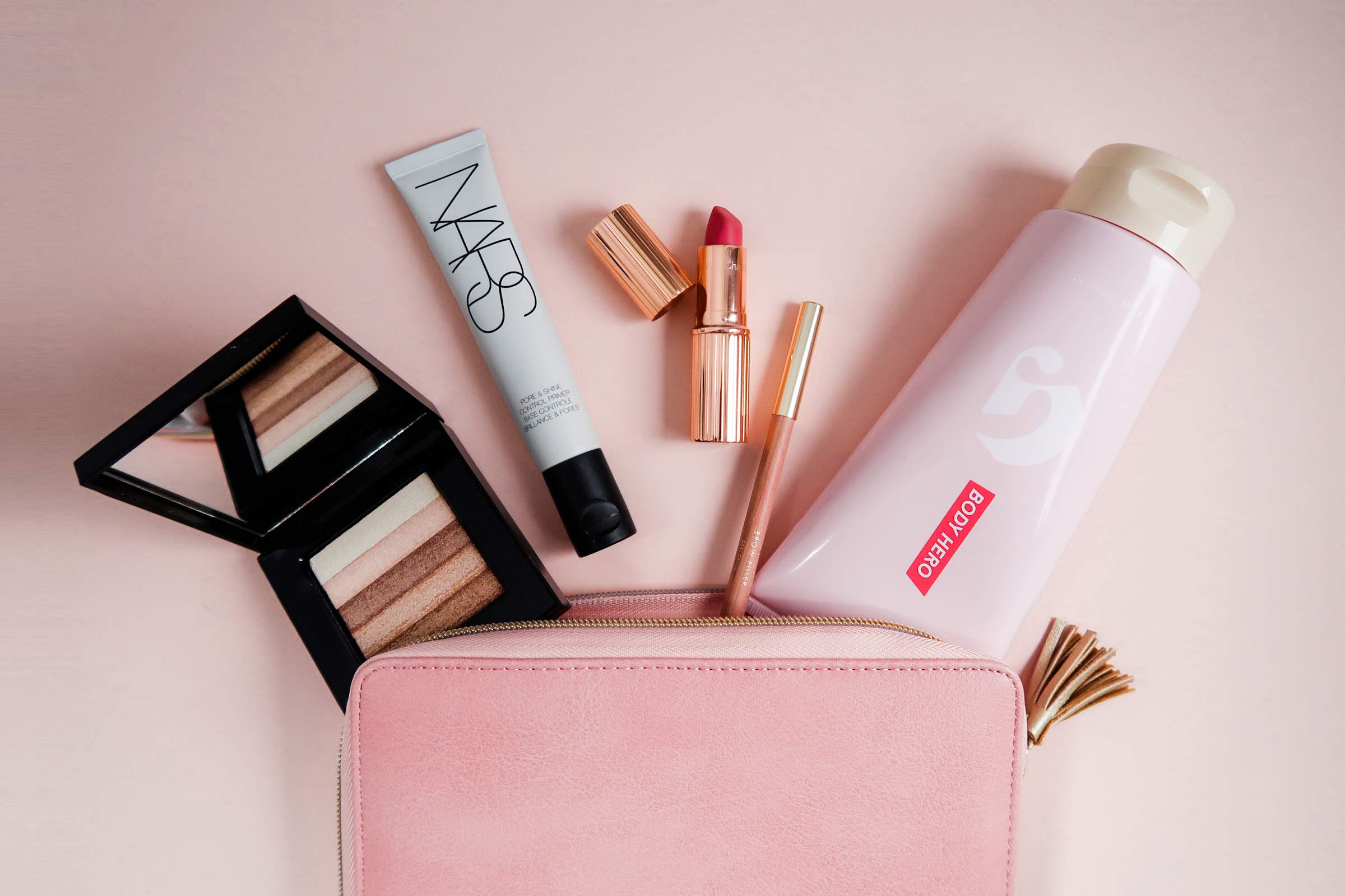 Beauty products I'm loving this month, including Glossier Body Hero lotion, Bobbi Brown highlighter, Charlotte Tilbury matte lipstick, and NARS primer | Sundays and Somedays