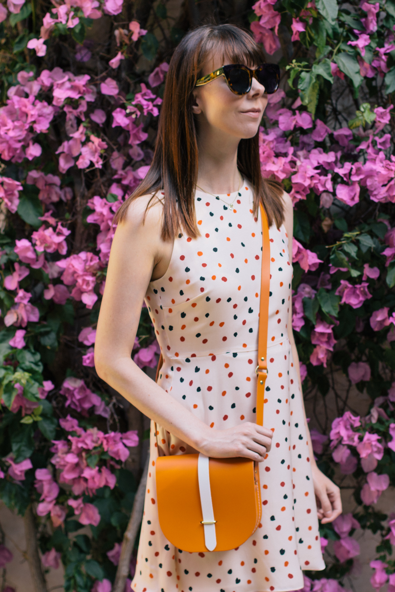Wandering around Seville, Spain with a sunset orange saddle bag from the Cambridge Satchel Company   Sundays and Somedays