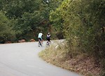 11948-a-couple-bike-riding-on-a-road-surrounded-by-trees-in-early-autumn-th.jpg