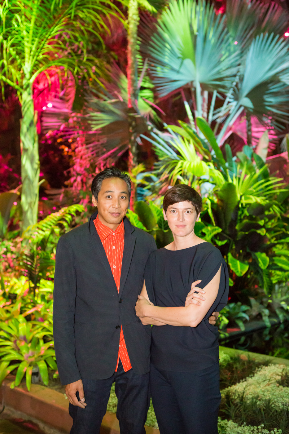 Luftwerk artists Sean Gallero and Petra Bachmaier lit by their installation.