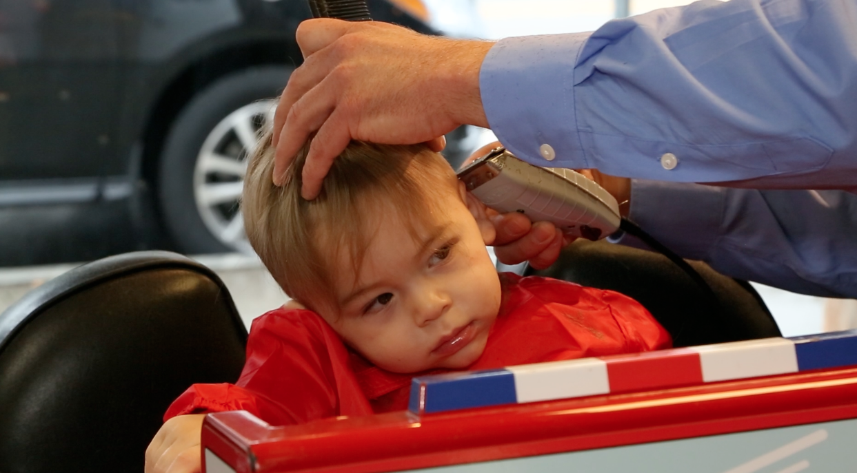 Keep it Brief- All stylist/barbers want to give the best haircut possible,however children have a short attention span. Most of the time it is best to try to get the haircut done in a quick manner (12-15 min) so the child can leave having had a comfortable experience. For the first few haircuts recommend keeping the haircuts simple and as the child grows and gets more familiar with the establishment and haircut process they will be more able to sit still for more detailed haircuts.