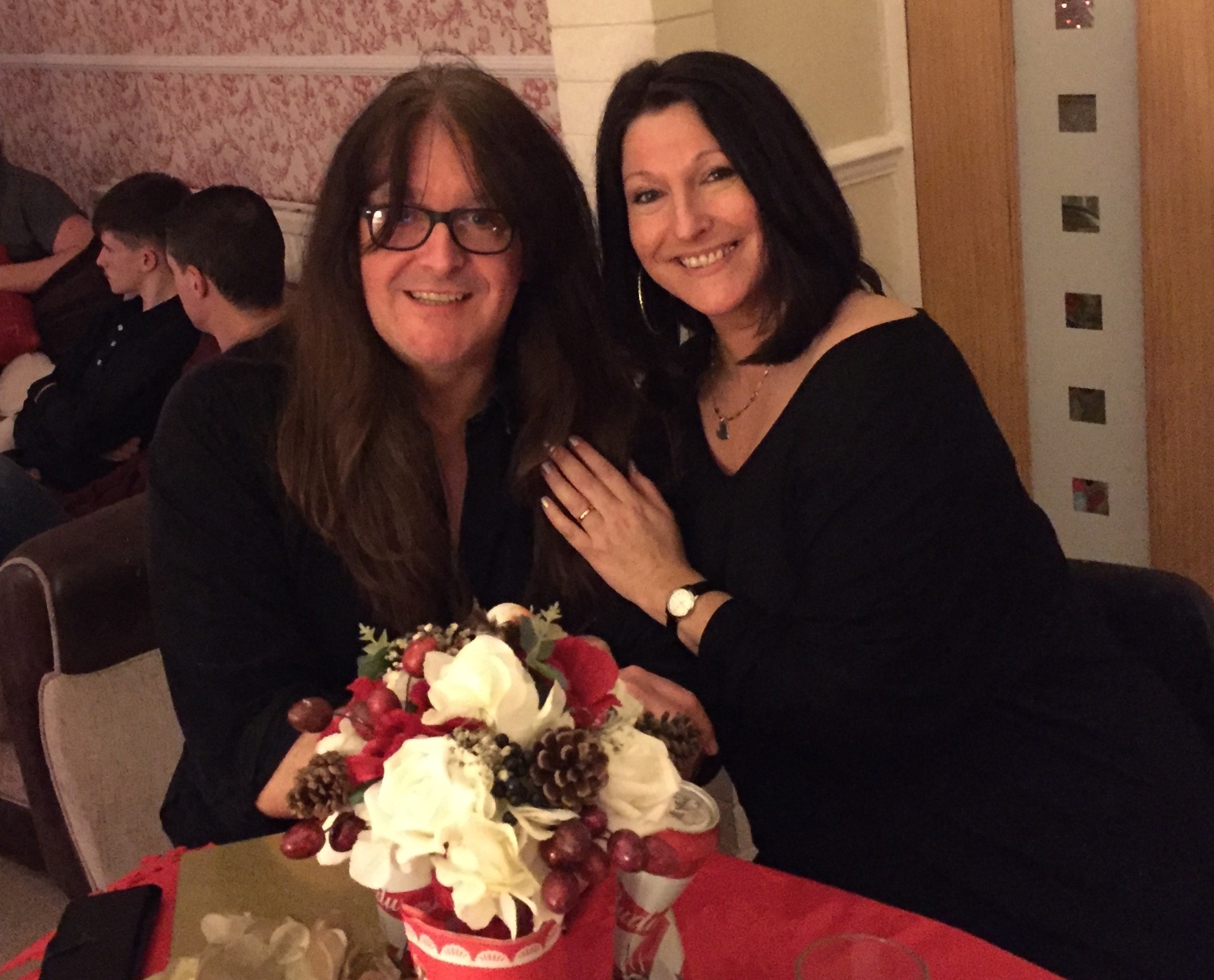 """Yep, it's John Paul Vaughn (aka """"JP"""") and my sister-in-law Andrea. Her engagement ring is her mother's old wedding ring which JP had gold added to, to make it bigger to get the right fit. Lovely couple with fab hair-dos!!"""