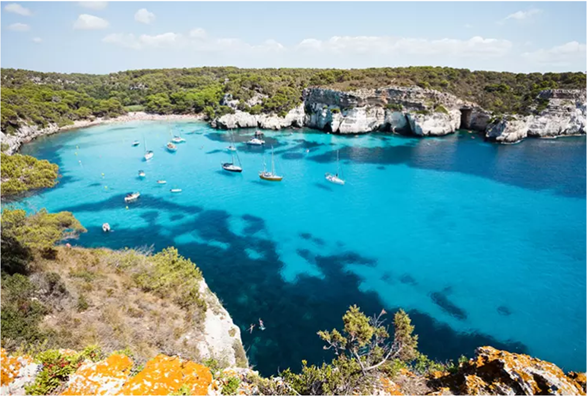Cala Macarella is one of the hidden delights of Menorca. Image by tagstiles.com - S.Gruene / Shutterstock