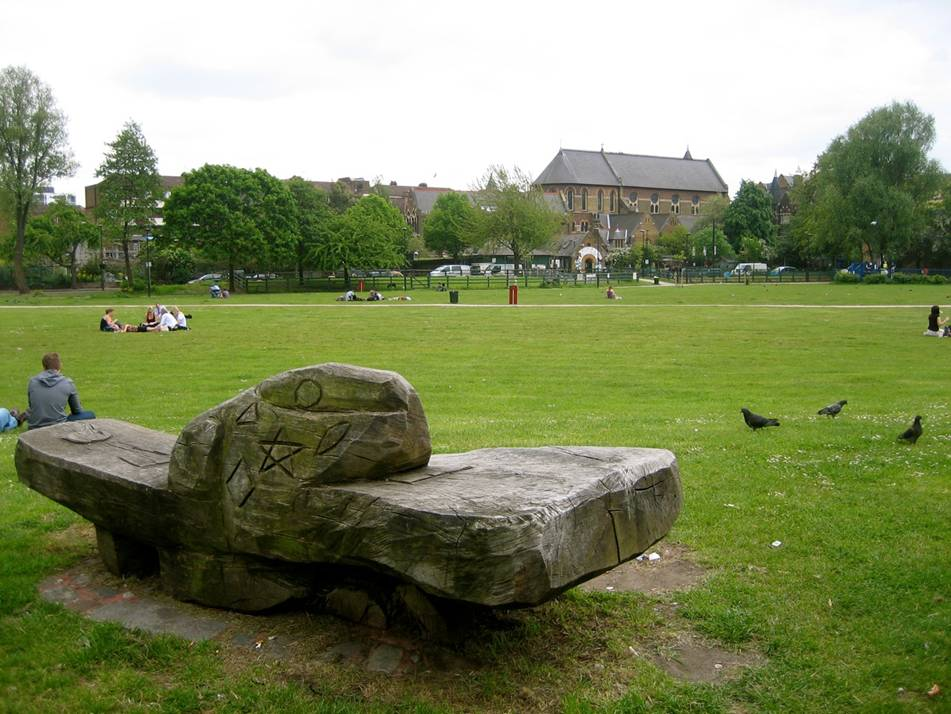The main lawn overlooking Vauxhall City Farm with Friedel Buecking's Sculpted bench in the foreground