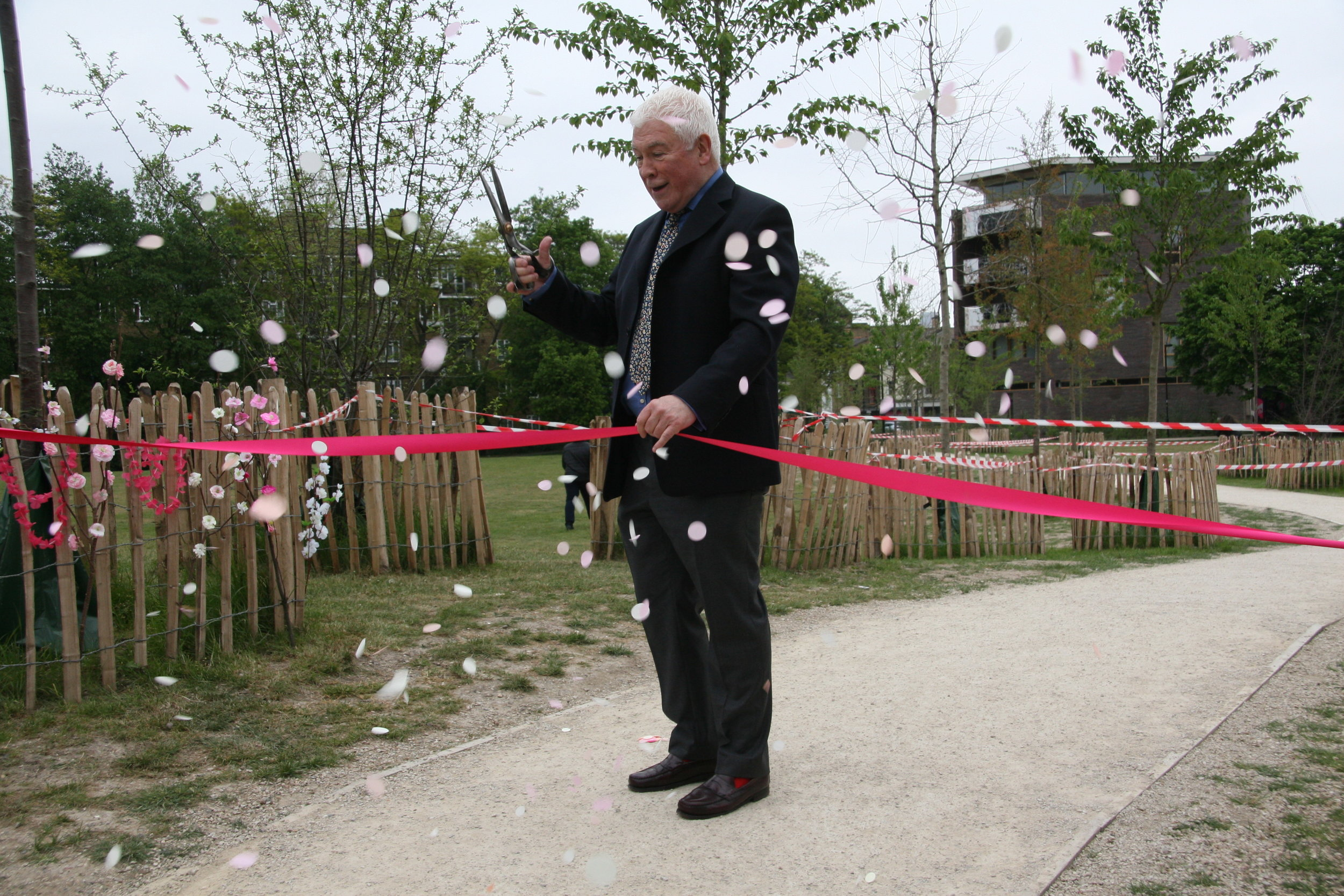 Sean Rafferty prefers to cut the ribbon