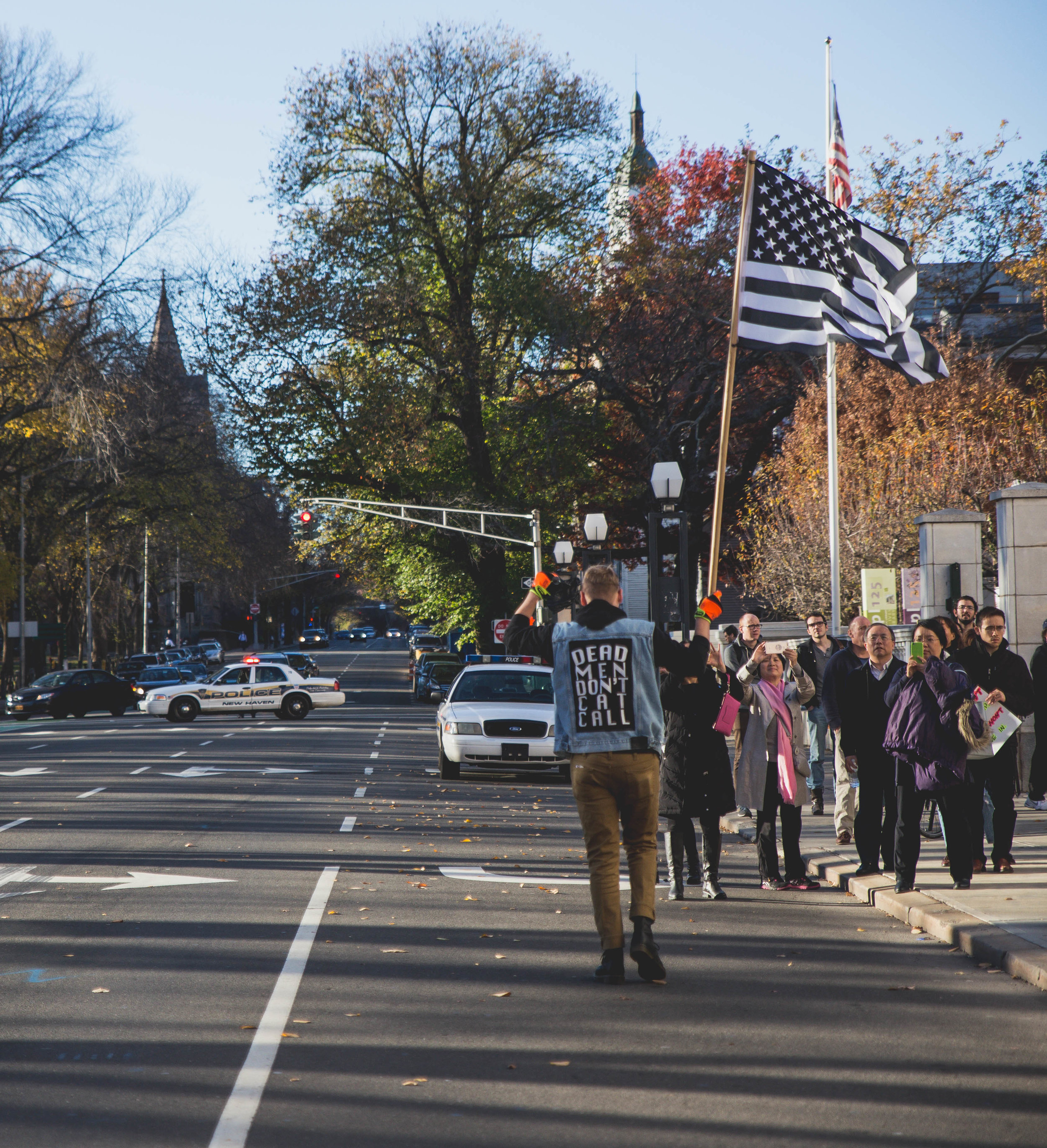 New Haven, Connecticut - November 13th, 2016: Police block off a street for the protesters who are in the street, most likely for safety reasons.