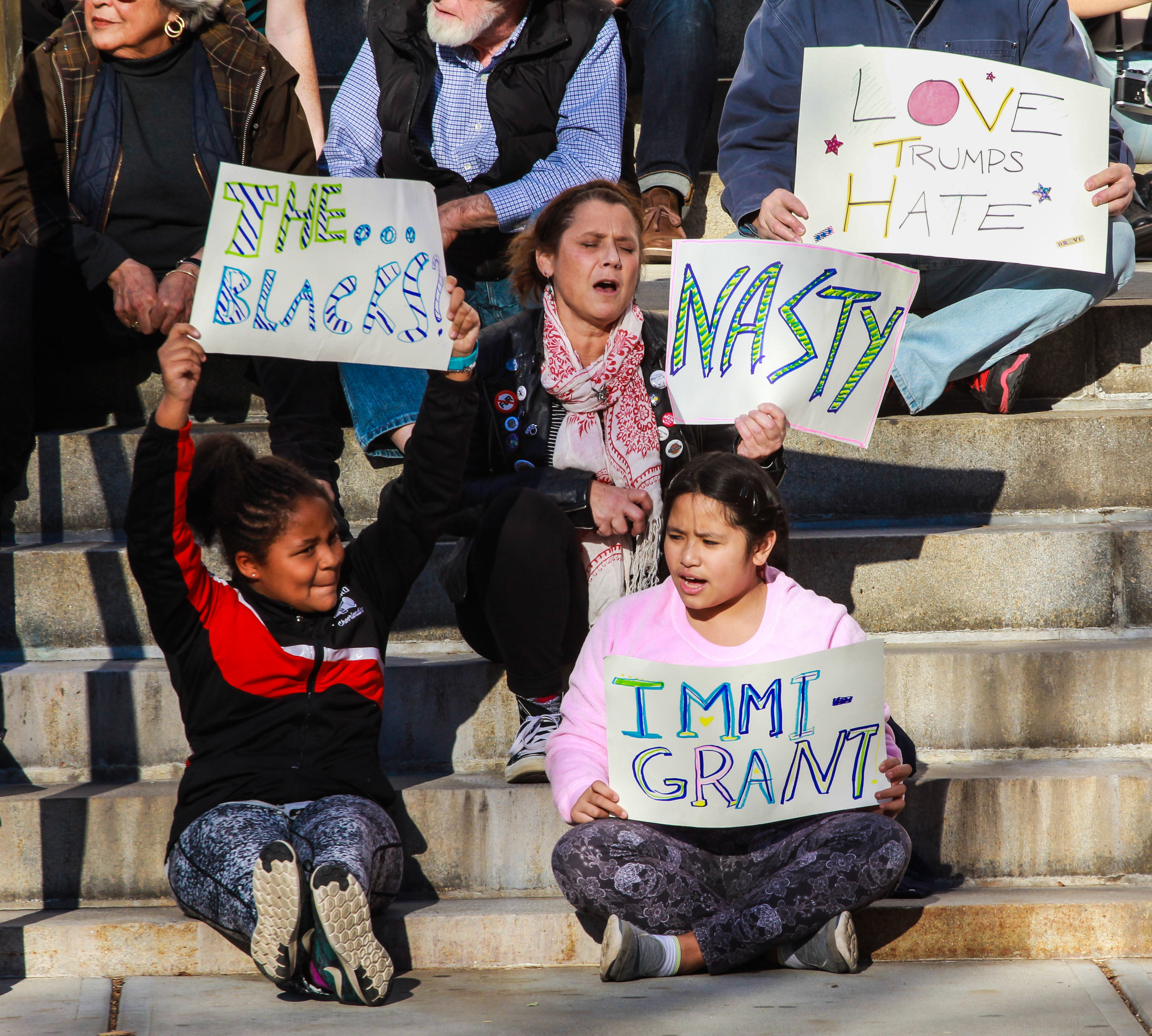 New Haven, Connecticut - November 13th, 2016: Children protesting with signs using words Trump had used in his campaign prior to being elected.