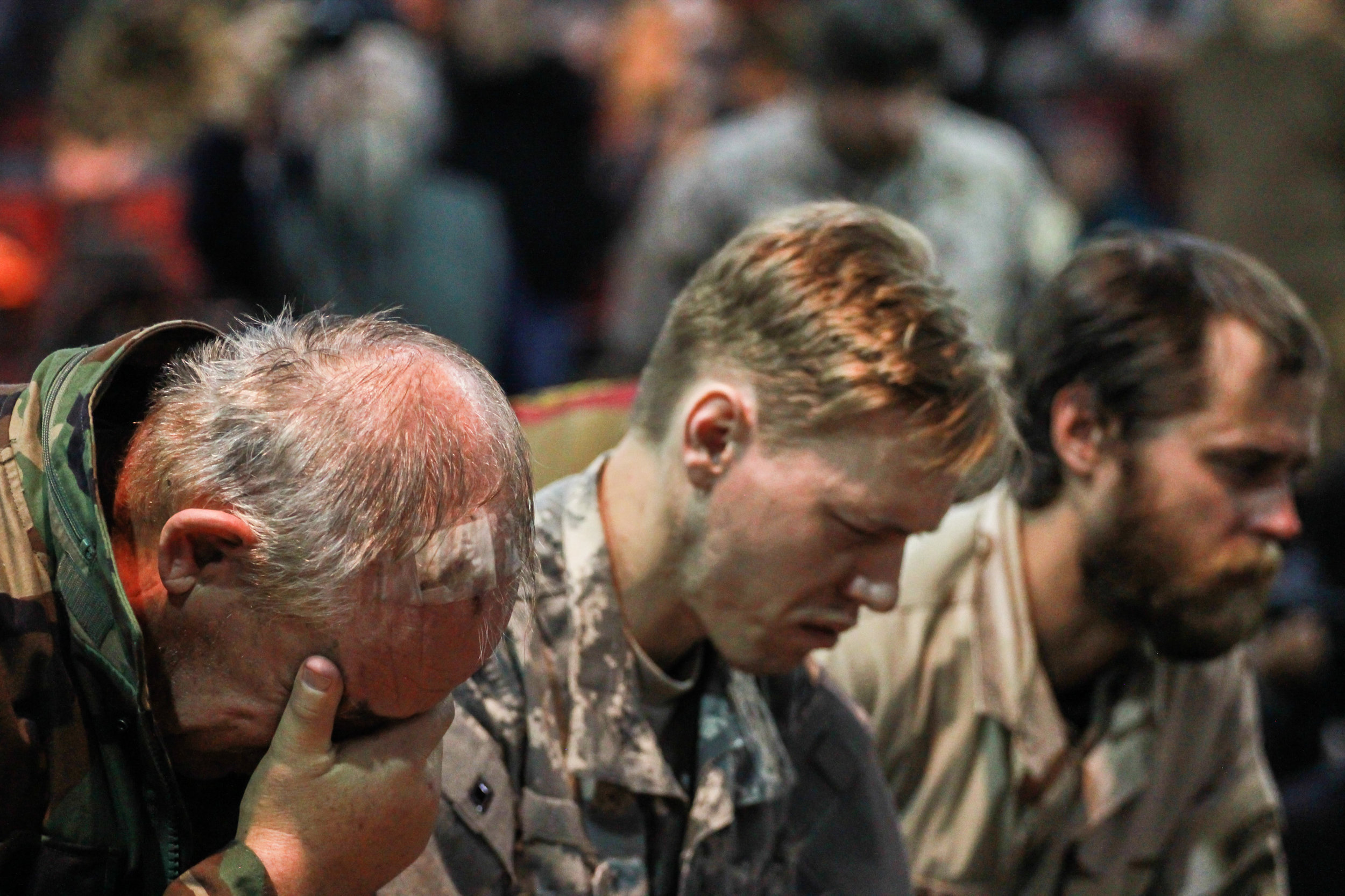 The veterans kneel for forgiveness, but they aren't the only ones who can't hold themselves together. Many of the people in the room, including journalists and civilians, continued to cry throughout the entire ceremony.  Fort Yates, ND December 5th, 2016.