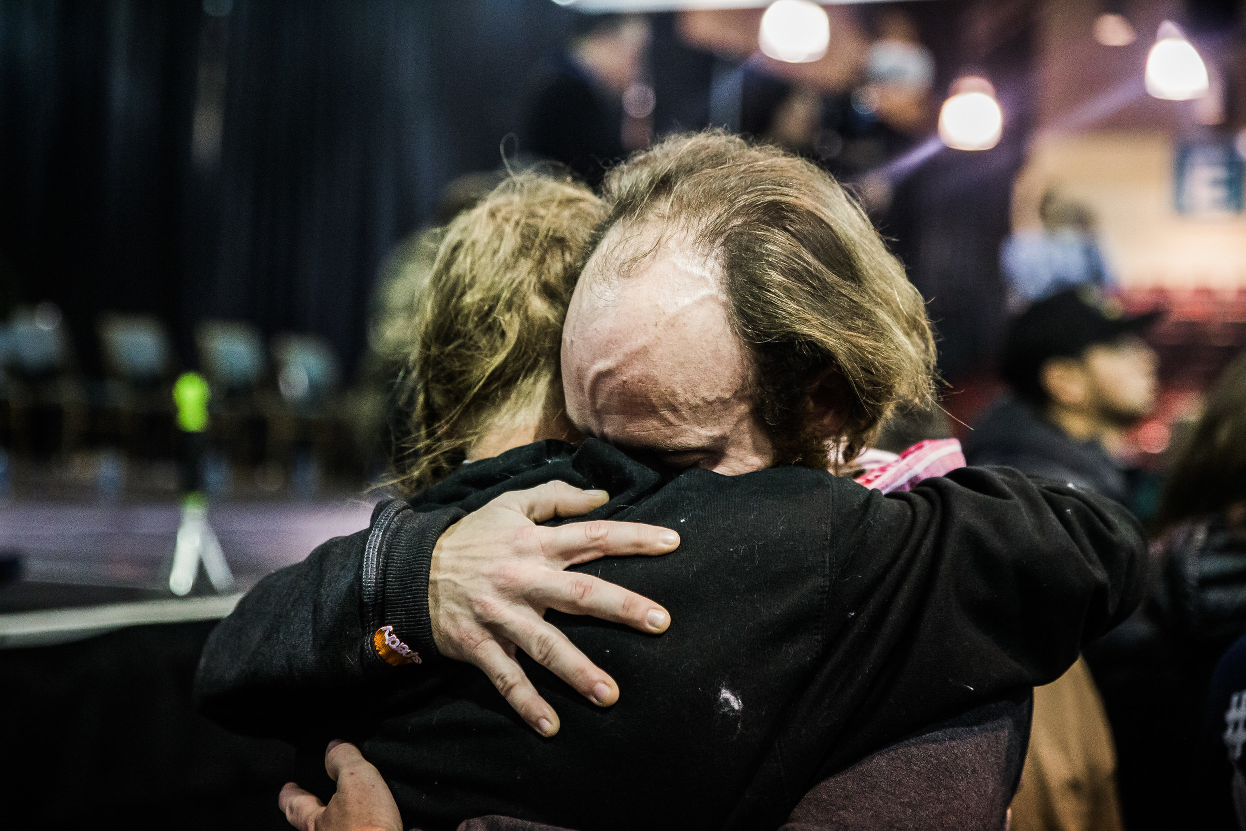 Two veterans embrace each other during a prayer sung by the Elders. With emotions running high during the forgiveness ceremony, many veterans broke down into tears. Looking around, you could see how much this meant to everyone.  Fort Yates, ND December 5th, 2016.