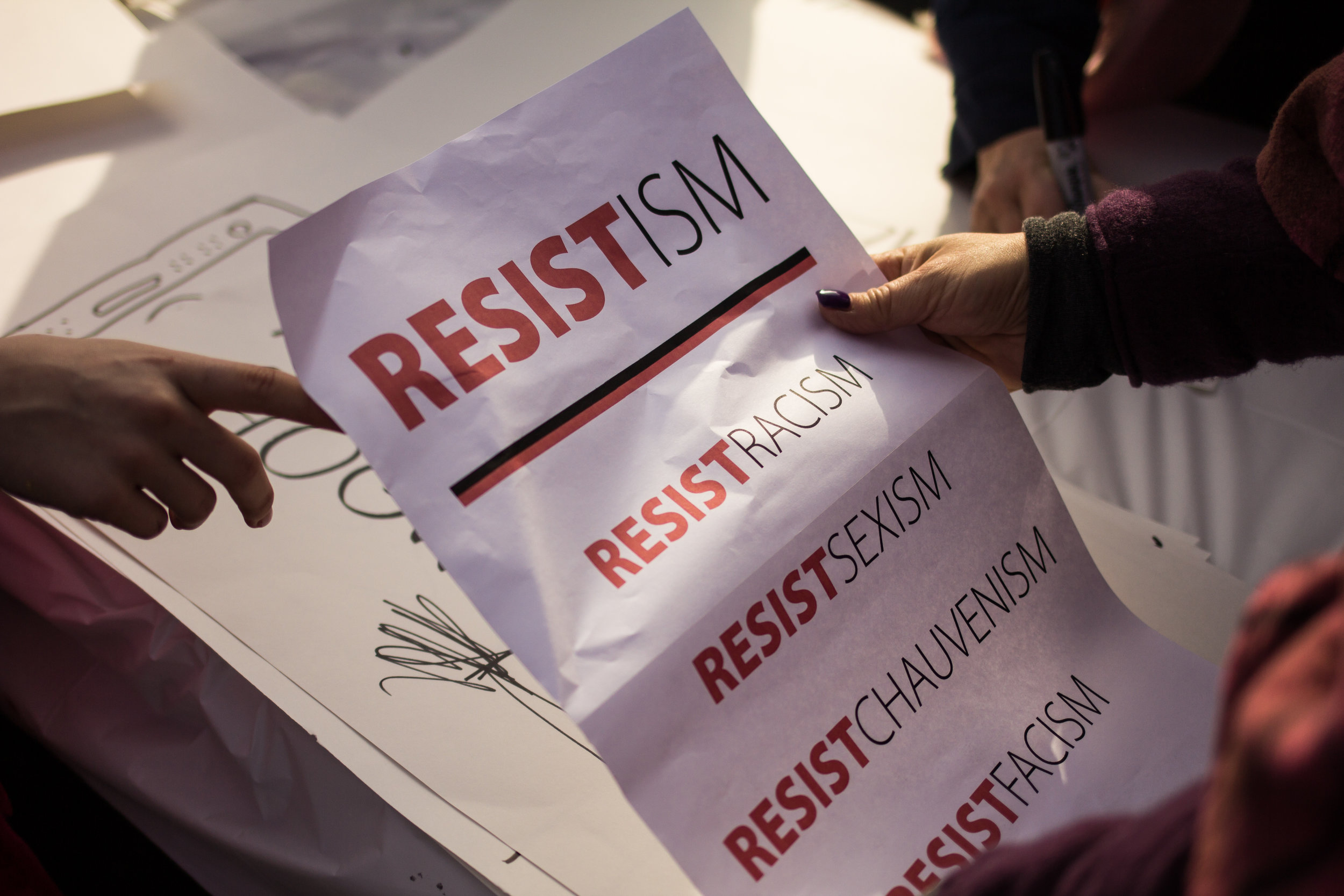 Stamford, Connecticut - January 21st, 2017: A woman holds a flyer being passed out at the Womens March the day after president Trumps inaguration.