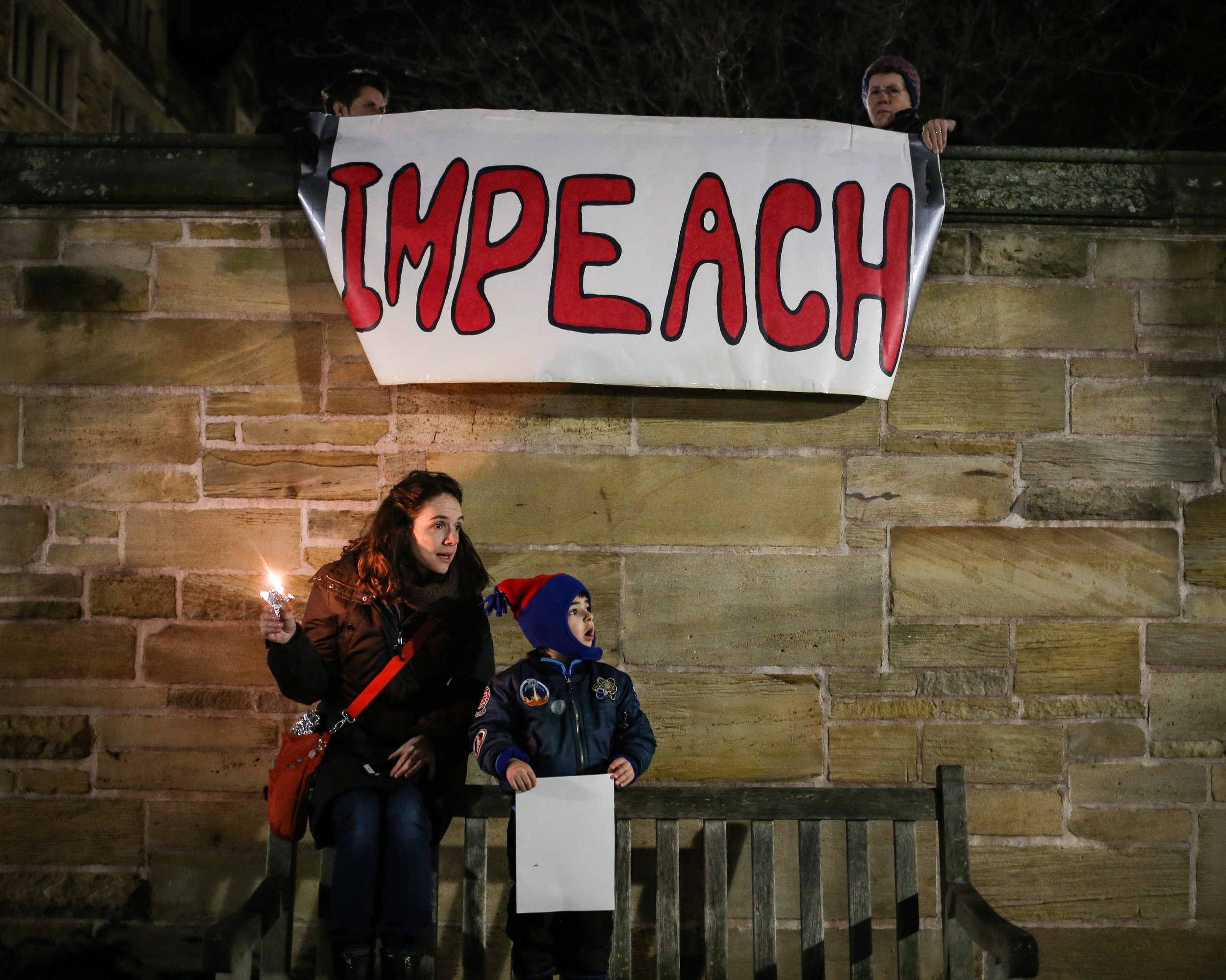 New Haven, Connecticut - January 29th, 2017: A vigil is held for immigrants and refugees following president Trump's executive order to ban specific countries from entering the United States.