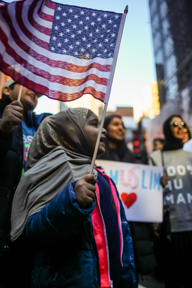 A young girl chants with a crowd and her little brother at the I Am A Muslim Too rally // February 19th, 2017 // New York City